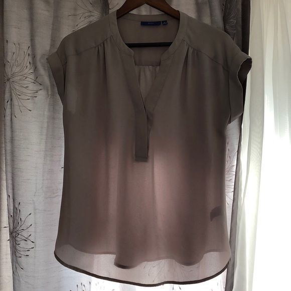 Small, gray apartment 9 blouse
